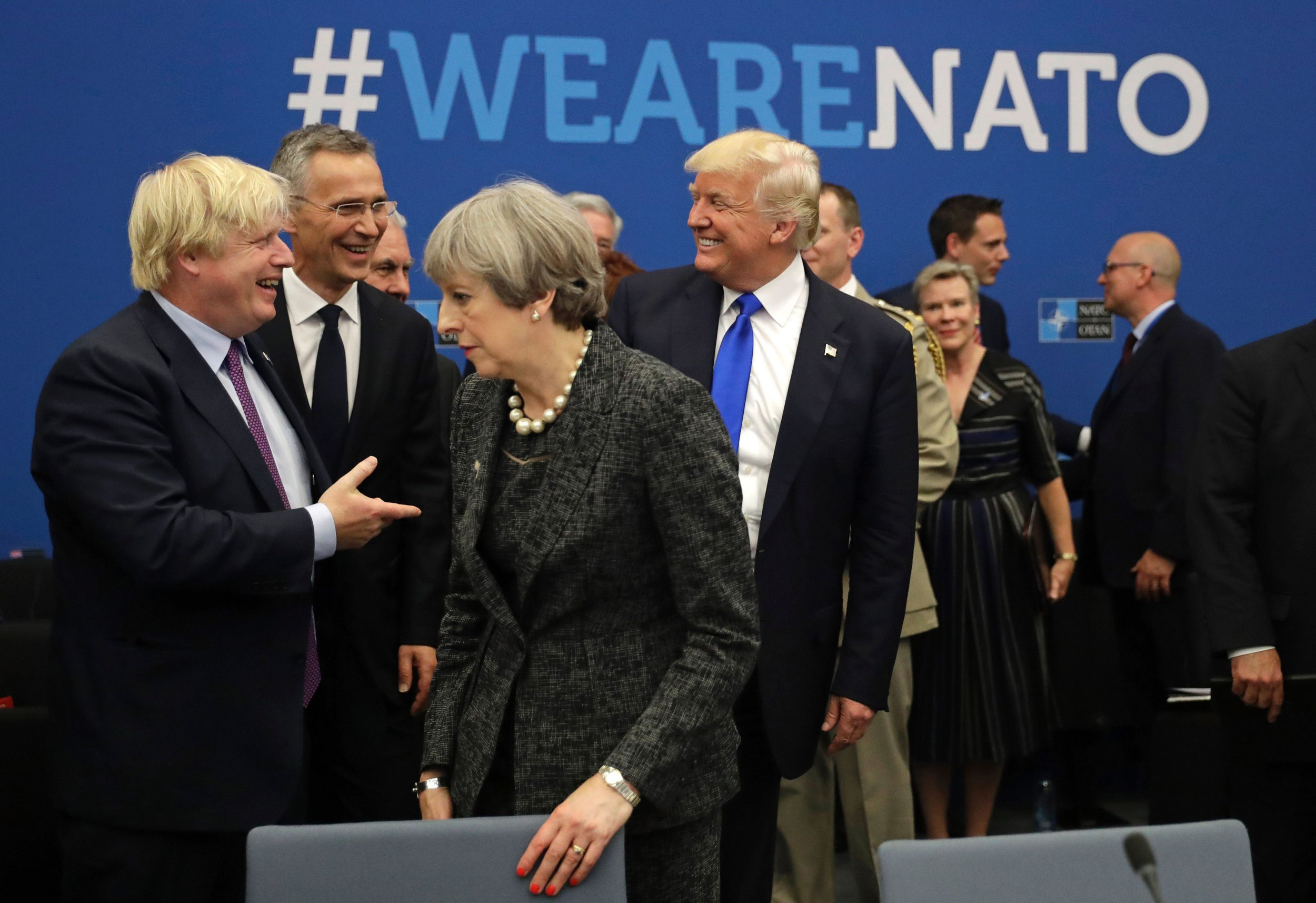 U.S. President Donald Trump (C) reacts while speaking to NATO Secretary General Jens Stoltenberg (2-L) and British Foreign Minister Boris Johnson (L) as Britain's Prime Minister Theresa May passes during a working dinner meeting at the NATO (North Atlantic Treaty Organization) headquarters in Brussels on May 25, 2017 during a NATO summit. / AFP PHOTO / POOL / Matt Dunham (Photo credit should read MATT DUNHAM/AFP/Getty Images)