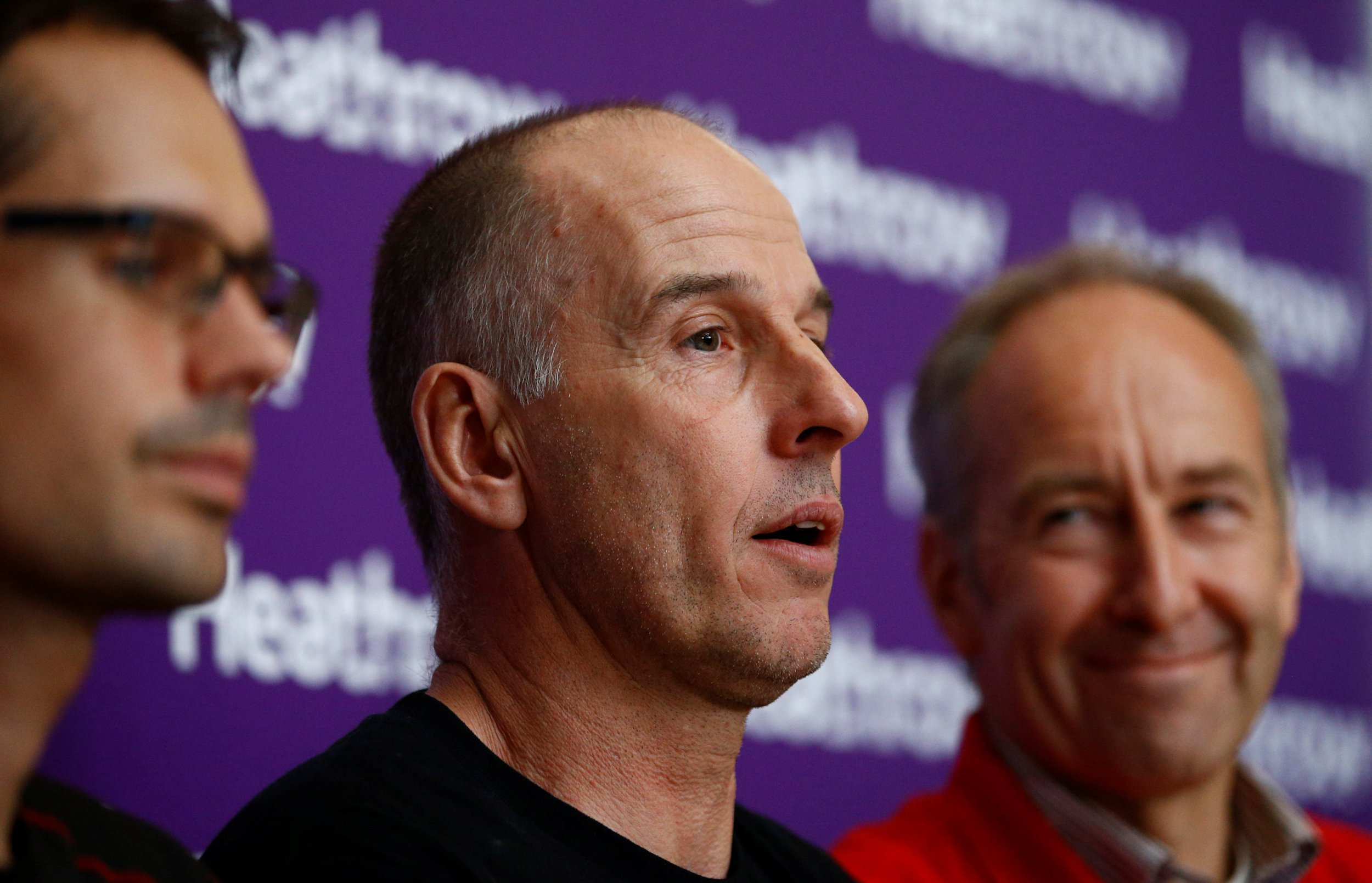 British cave divers, Rick Stanton, Chris Jewell, and Chairman of the British Cave Rescue Council Peter Dennis speak to the media at a news conference at Heathrow Airport, having helped in the rescue of the 12 boys in Thailand, in London, Britain, July 13, 2018. REUTERS/Henry Nicholls