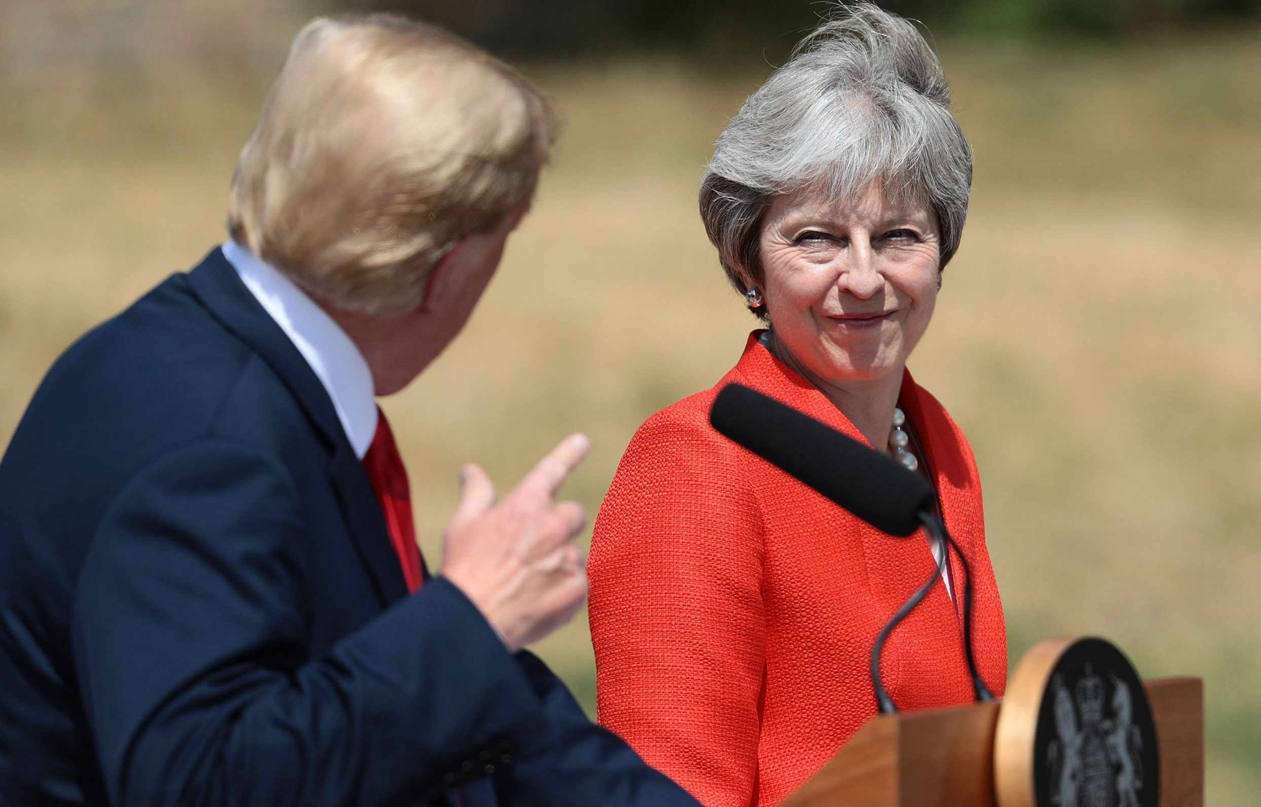 AYLESBURY, ENGLAND - JULY 13: Prime Minister Theresa May and U.S. President Donald Trump attend a joint press conference following their meeting at Chequers on July 13, 2018 in Aylesbury, England. US President, Donald Trump, held bi-lateral talks with British Prime Minister, Theresa May at her grace-and-favour country residence, Chequers. Earlier British newspaper, The Sun, revealed criticisms of Theresa May and her Brexit policy made by President Trump in an exclusive interview. Later today The President and First Lady will join Her Majesty for tea at Windosr Castle. (Photo by Jack Taylor/Getty Images)