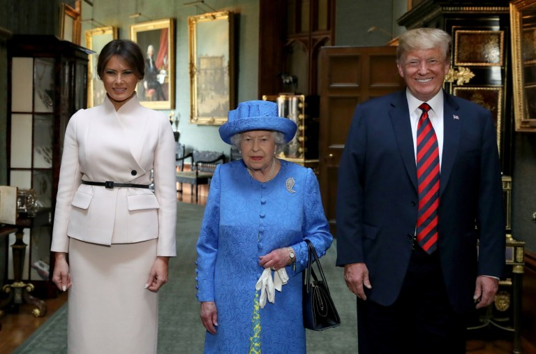 Queen Elizabeth II stands with US President Donald Trump and his wife, Melania, during their visit to Windsor Castle in Berkshire. PRESS ASSOCIATION Photo. Picture date: Friday July 13, 2018. See PA story POLITICS Trump. Photo credit should read: Steve Parsons/PA Wire