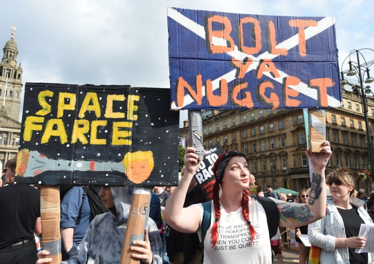 Demonstrators gather in George Square, Glasgow, for the Scotland United Against Trump protest against the visit of US President Donald Trump to the UK. PRESS ASSOCIATION Photo. Picture date: Friday July 13, 2018. See PA story POLITICS Trump. Photo credit should read: Lesley Martin/PA Wire