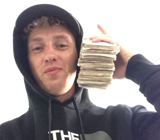 'Boastful' drug trafficker Mark Wainfur, 29, from Sycamore Avenue, Newport, posing with a huge wad of cash estimated to be in the thousands