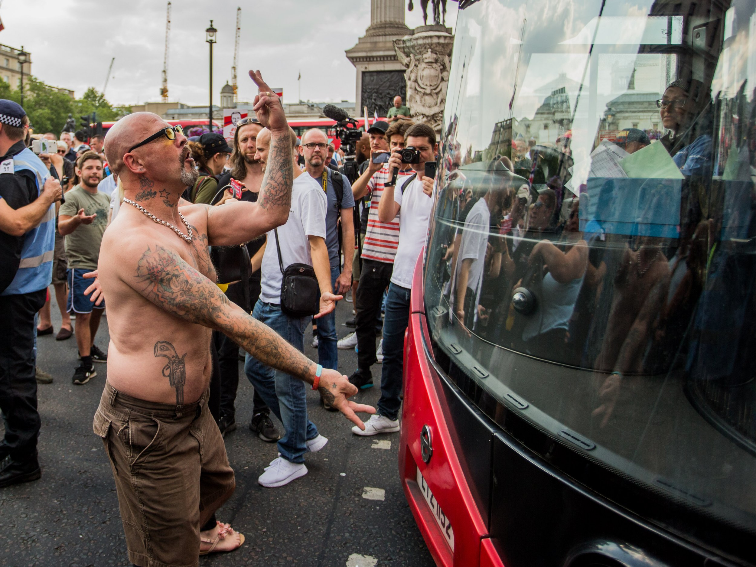 Supporters of jailed EDL founder Tommy Robinson bring traffic to a halt in London's Trafalgar Square following rally earlier in the day on Whitehall. Featuring: Atmosphere, View Where: London, England, United Kingdom When: 14 Jul 2018 Credit: Wheatley/WENN