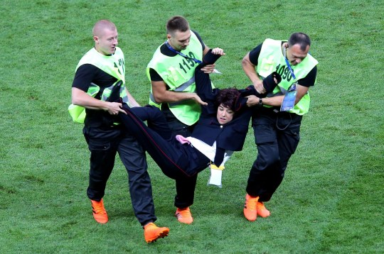 Mandatory Credit: Photo by Michael Zemanek/BPI/REX/Shutterstock (9762118kc) Pussy Riot protesters invade the pitch during the World Cup final and are forcibly removed by security France v Croatia, Final, 2018 FIFA World Cup football match, Luzhniki Stadium, Moscow, Russia - 15 Jul 2018
