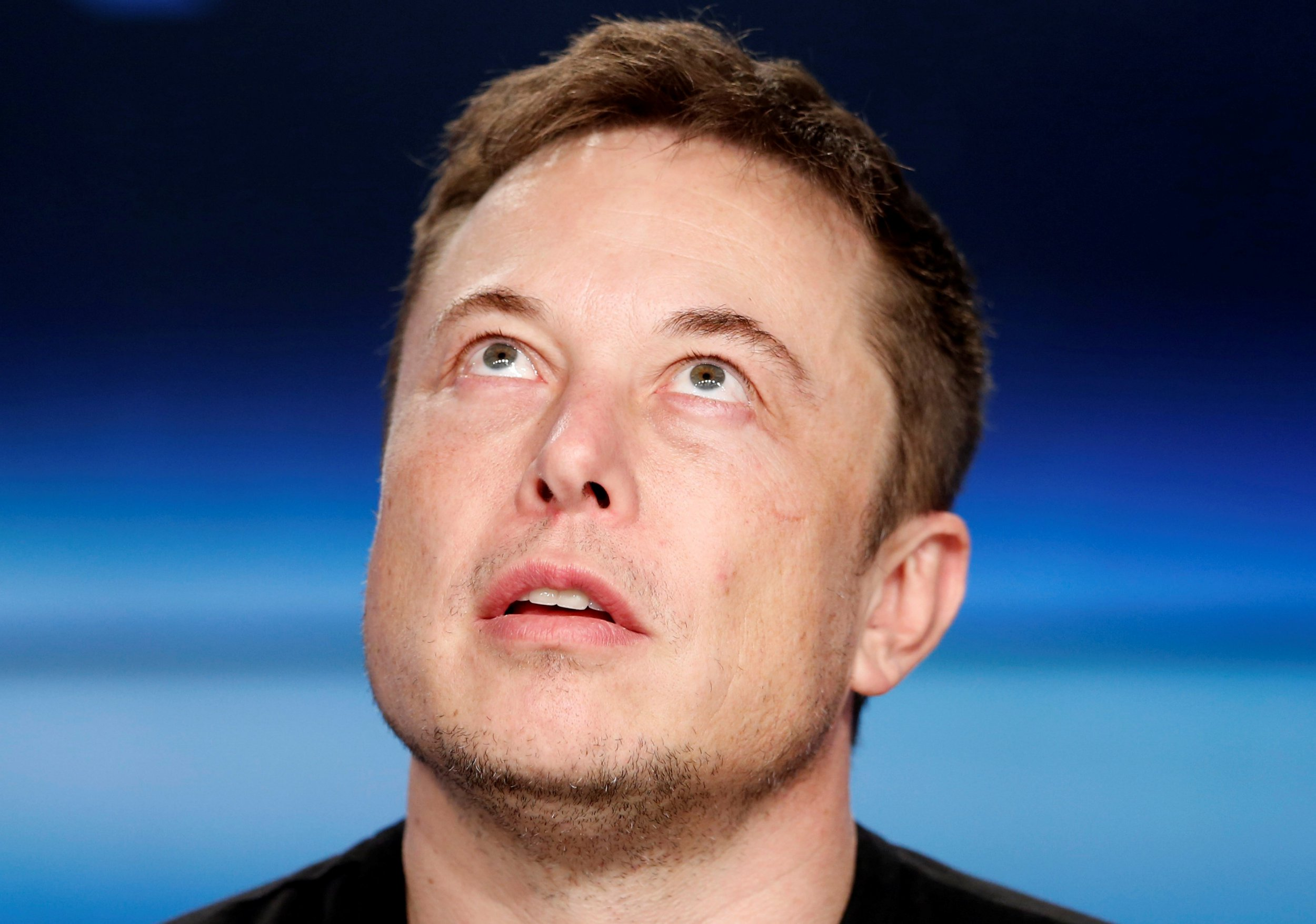 FILE PHOTO: SpaceX founder Elon Musk pauses at a press conference following the first launch of a SpaceX Falcon Heavy rocket at the Kennedy Space Center in Cape Canaveral, Florida, U.S., February 6, 2018. REUTERS/Joe Skipper/File Photo