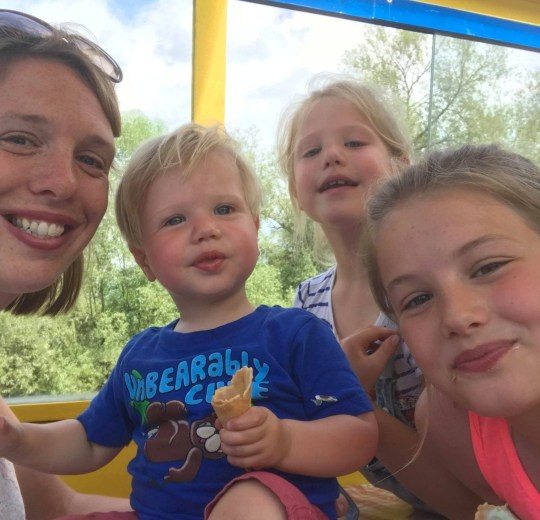 """Andrea Elcock, 35, Ward, 1, Florence, 7, and Poppy-Anne, 10. See SWNS story SWPREG; An air hostess has won a discrimination case against her former employer after she was fired from her """"dream job"""" due to pregnancy related health issues. Andrea Elcock, 35, suffered agonising pain during her third pregnancy and had to use crutches to get around as her joints were 'pushed to the limit'. She was diagnosed with Ehlers-Danlos syndrome, EDS, and was signed off work for three months - unable to return after giving birth to her son, Ward. Things went from bad to worse when Andrea was fired by the Guernsey based airline Blue Islands, and to her shock hey even tried to claim damages - for ?2,303.85"""