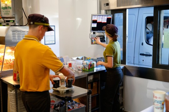 Employees prepare a customer's drive-thru food order inside a McDonald's Corp. restaurant in Manchester, U.K., on Monday, Aug. 10, 2015. McDonald's Chief Executive Officer Steve Easterbrook predicted a return to growth for the burger chain in the second half of the year, giving investors cause for optimism after another quarter of slumping sales. Photographer: Paul Thomas/Bloomberg via Getty Images