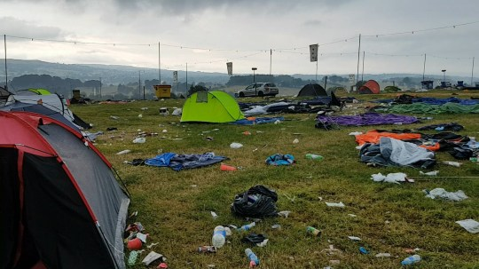 PIC FROM Kennedy News and Media (PICTURED: THE SEA OF TRASH AND TENTS LEFT BEHIND BY MILLENNIAL FESTIVAL-GOERS AFTER BEAT-HERDER FESTIVAL) Shocking footage shows the sea of trash left behind by summer festival-goers, which staff have branded an 'environmental disaster' thanks to Millennials' throwaway culture. Leon Phythian has been helping out at the Beat-Herder Festival for the last 12 years but felt compelled to film the state that the picturesque area of Gisburn, Lancs, was left in this week. His appalling footage shows countless tents, chairs and other debris left behind in the wake the weekend's festival surrounded by trash and litter in what was a 'beautiful' field. SEE KENNEDY NEWS COPY - 0161 660 8596