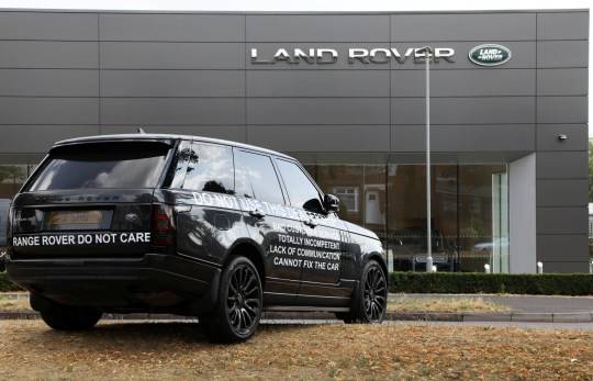 "A motorist has plastered their ?63,000 Range Rover Vogue with slogans and left it outside a Birmingham dealership in an apparent dispute. See NTI story NTIROVER. The Lancaster Land Rover customer parked the black 2016 vehicle on the central reservation, facing towards the Tyburn Road showroom in Erdington, Birmingham. The driver staged the one-car protest in an apparent bid to put off future customers. Stickers attached to both sides of the car read: ""Range Rover do not care. Do not use this dealership. Bad customer service, totally incompetent, lack of communication, cannot fix the car."" The issues leading to the car being dumped were unclear. The dealership confirmed it was aware of the vehicle and staff were due to meet with the customer to 'agree a way forward'."