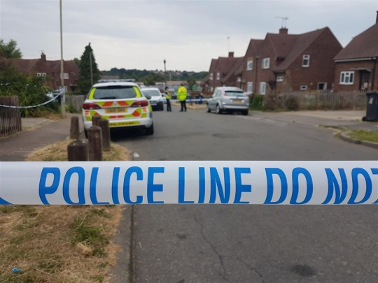 The scene in Godwin Road, Thanington where police are investigating a shooting, July 20 2018. See SWNS story SWSHOT; Armed police were called to a housing estate after a man suffered a bullet wound in a shooting. The victim - who is in his 20s - is thought to have been shot in Godwin Road, Thanington, which remains closed off by police. But he was actually found seriously injured a mile away, in Oxford Road, Wincheap, shortly before 10.40pm last night. But the helicopter was not needed and the victim was taken to hospital by road. One witness said he saw two men in balaclavas arrive at nearby Alfred Road in a silver Audi with the windows blacked out.