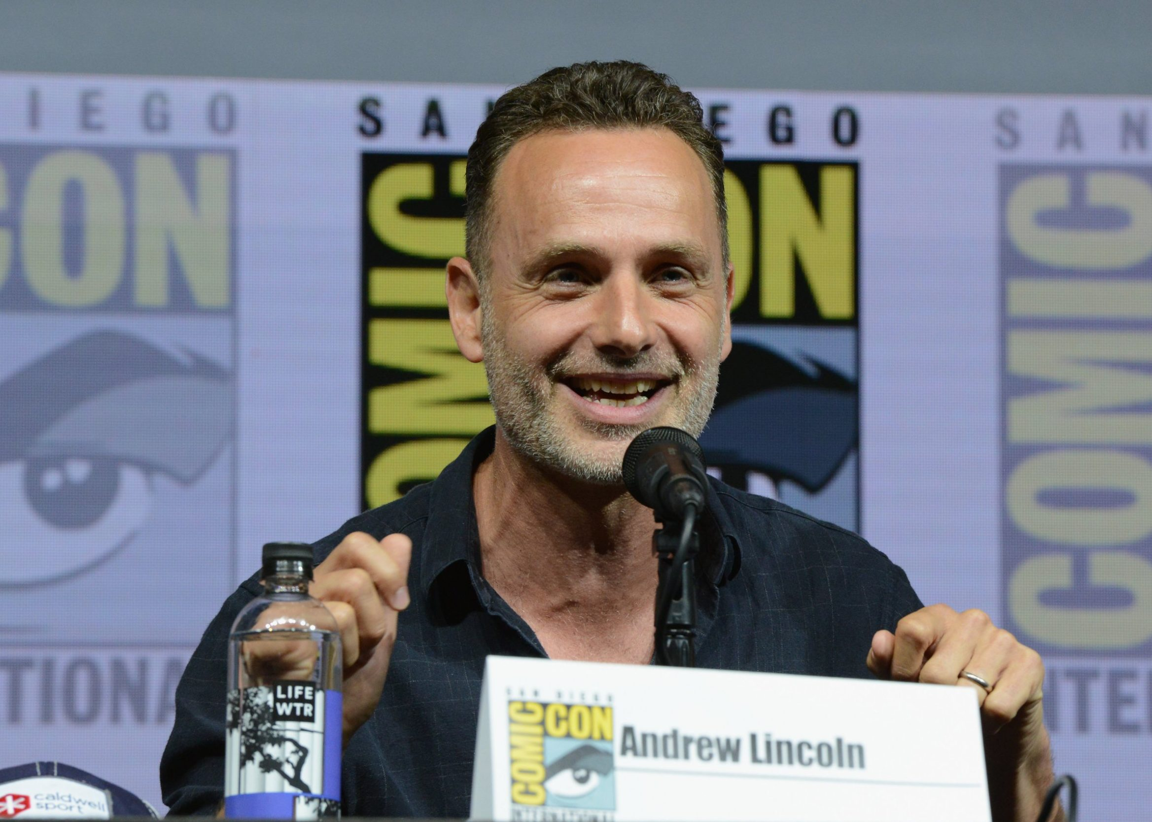 """SAN DIEGO, CA - JULY 20: Andrew Lincoln speaks onstage at AMC's """"The Walking Dead"""" panel during Comic-Con International 2018 at San Diego Convention Center on July 20, 2018 in San Diego, California. (Photo by Albert L. Ortega/Getty Images)"""