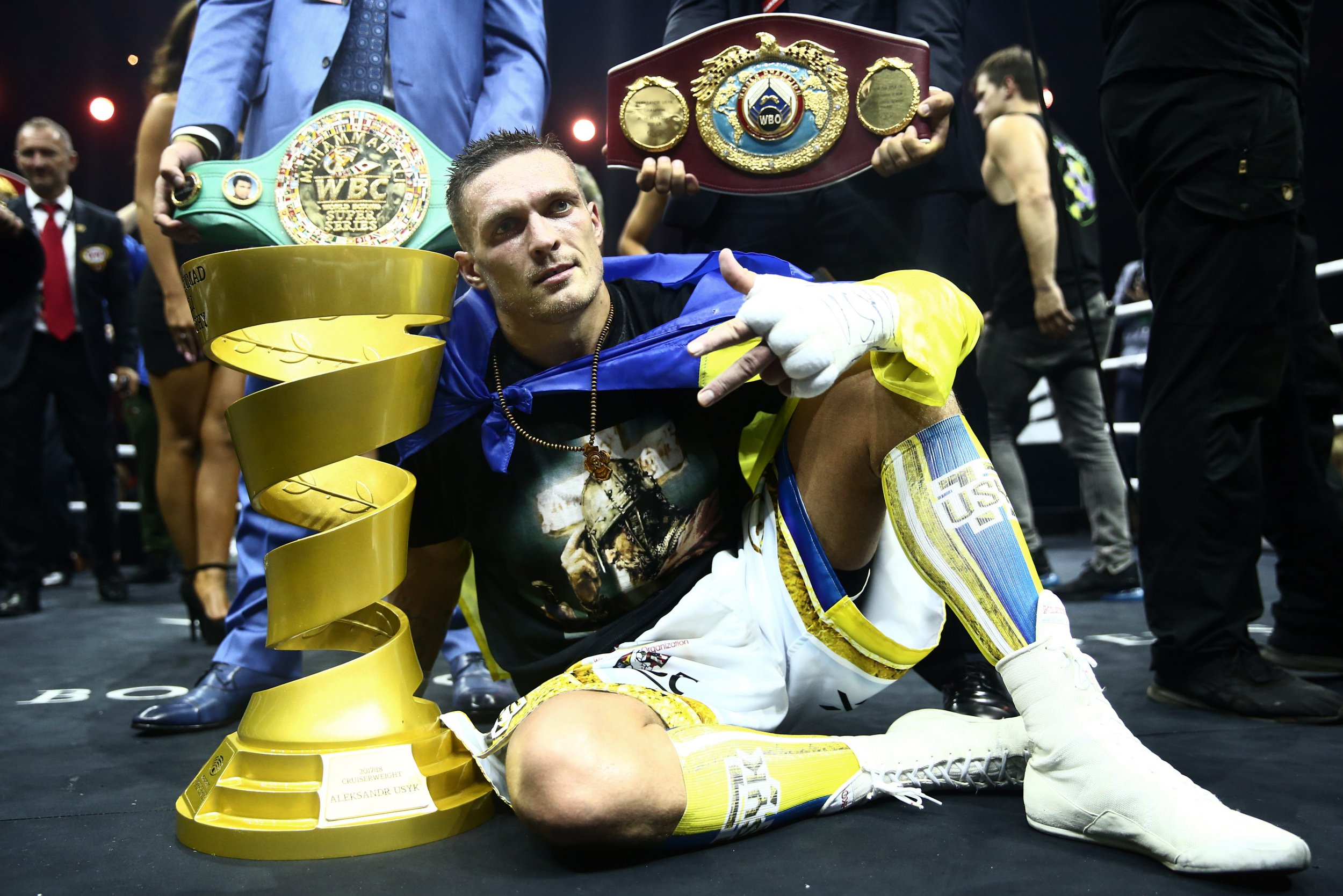 MOSCOW, RUSSIA - JULY 21, 2018: WBC/WBO champion Oleksandr Usyk (front) of Ukraine, poses with the Muhammad Ali Trophy as he wins his WBSS (World Boxing Super Series) cruiserweight final bout against WBA/IBF champion Murat Gassiev of Russia, at Moscow's Olympiyskiy Arena. Valery Sharifulin/TASS (Photo by Valery Sharifulin\TASS via Getty Images)