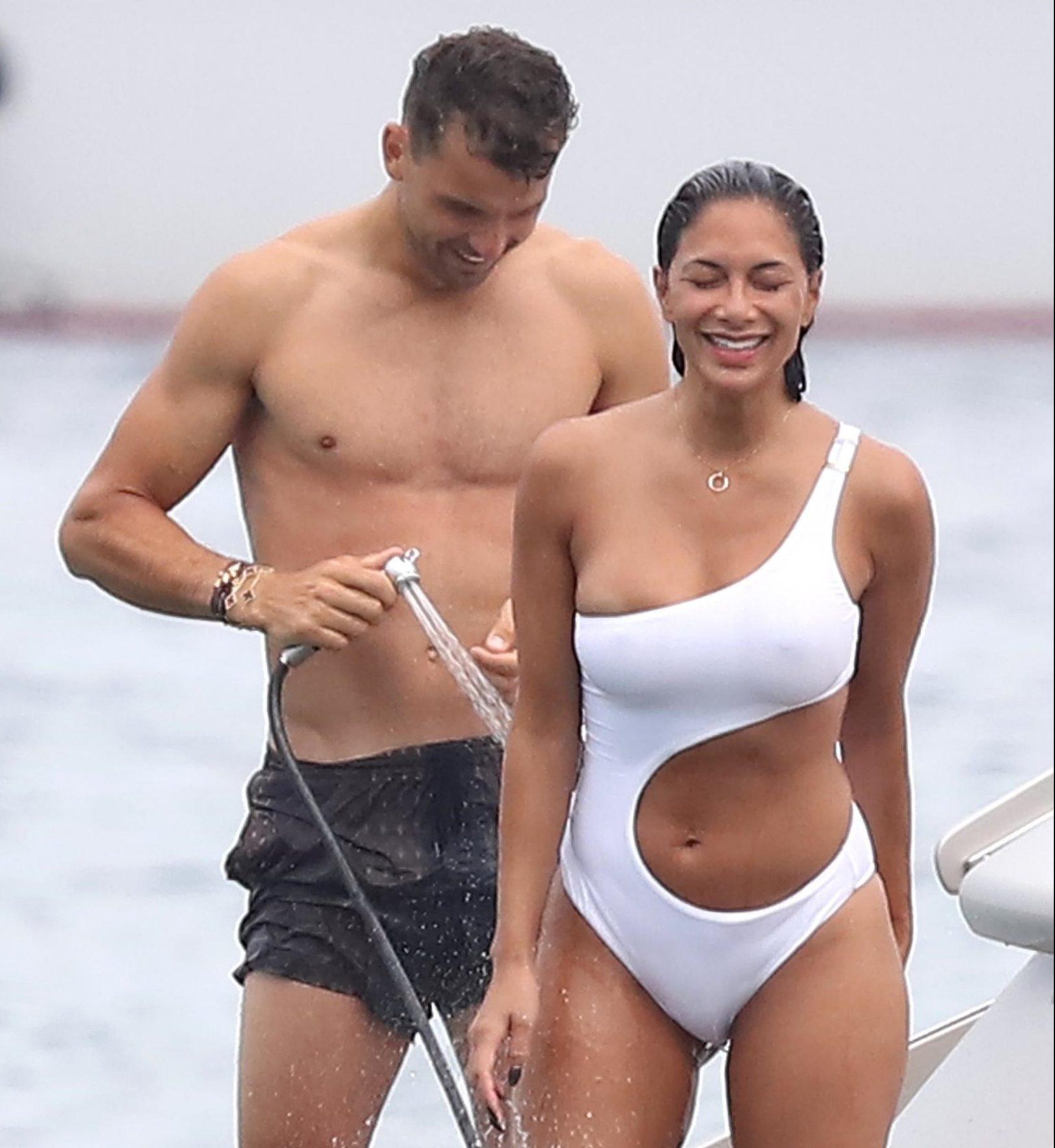 Nicole Scherzinger gets a hose down from boyfriend Grigor Dimitrov aboard luxury yacht