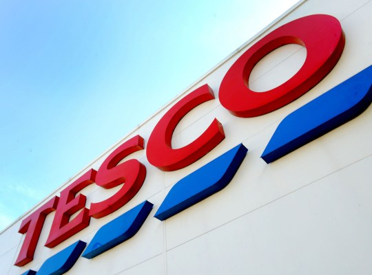 "File photo dated 26/08/16 of a Tesco sign, as the UK's biggest supermarket has posted a surge in annual profits as it hailed a year of ""strong progress"" after more than two straight years of rising sales and the completion of its £3.7 billion Booker deal."
