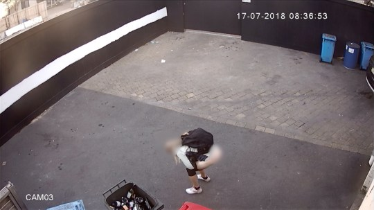 MERCURY PRESS. 24/07/18. Pictured: A screenshot from a video showing the jogger squating down with her pants at her ankles. This is the moment a blonde jogger was caught DEFECATING at the back of a wine shop during a morning run - leaving a large deposit for horrified staff to clean up. CCTV shows a woman casually sauntering into the courtyard behind Porters Liquor, in Syd-ney, Australia, at 08.36am last week [July 17]. The shameless poopetrator then pulls her leggings down, squats low for 60 seconds and unleashes a torrent of excrement before wiping herself twice on tissue and tossing it to the ground. Disgusted store owner Jim Shwilk said this is the SECOND time he has seen the runner use the courtyard as a public toilet in 10 days - just yards from a busy road. He is appealing for the phantom pooper to seek appropriate assistance' and hopes releasing the footage will act as a deterrent. SEE MERCURY COPY