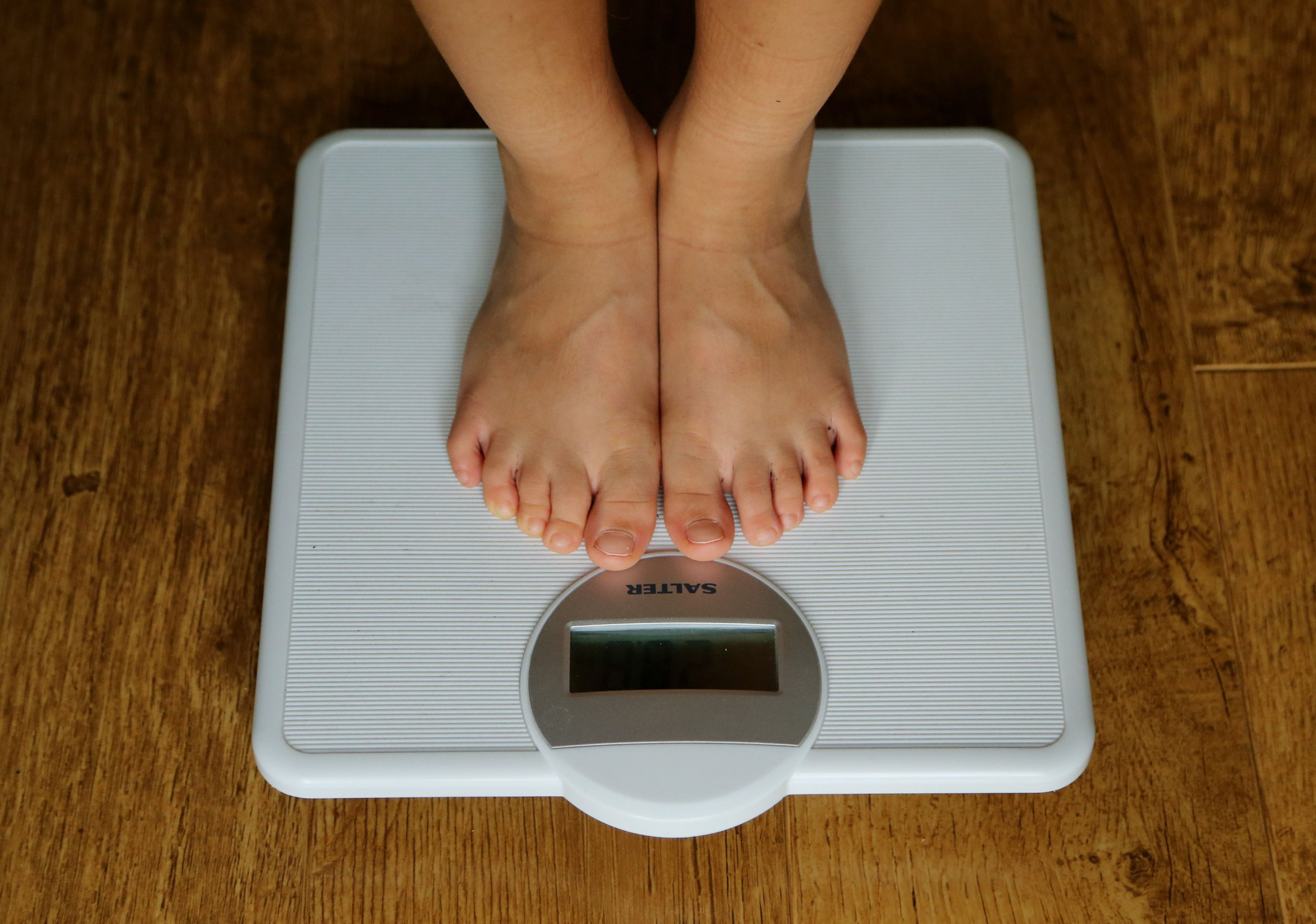"Embargoed to 2330 Wednesday July 04 File photo dated 15/07/14 of a child being weighed on scales. Children whose mums stay healthy while they grow up are ""substantially"" less likely to be obese, research suggests."