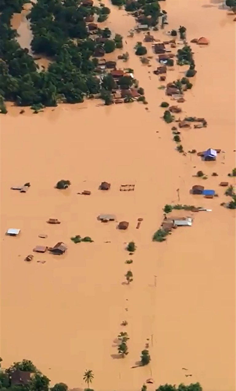 "This screen grab taken on handout video footage from ABC Laos on July 24, 2018 shows an aerial view of the flooded plains in Attapeu province after a dam collapsed the day before. Hundreds of people are missing and an unknown number believed dead after a partly-constructed hydropower dam in southeast Laos collapsed, sending flash floods surging through six villages, state media reported on July 24. / AFP PHOTO / ABC LAOS / Handout / -----EDITORS NOTE --- RESTRICTED TO EDITORIAL USE - MANDATORY CREDIT ""AFP PHOTO / ABC Laos"" - NO MARKETING - NO ADVERTISING CAMPAIGNS - DISTRIBUTED AS A SERVICE TO CLIENTS - NO ARCHIVESHANDOUT/AFP/Getty Images"