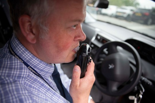 DI Andy Crowe demonstrates the in car alcohol interlock device which stops drink drivers from starting their engine if they are over the legal drink drive limit, at Durham Police headquarters. PRESS ASSOCIATION Photo. Picture date: Tuesday July 24, 2018. Durham Police will pilot the scheme to fit alcohol ?interlocks?, which mean the vehicle will be immobilised if the driver is over the limit. See PA story POLICE Drink. Photo credit should read: Owen Humphreys/PA Wire