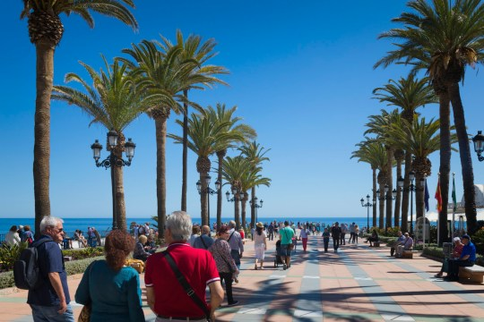 Nerja, Costa del Sol, Malaga Province, Andalusia, southern Spain. Crowds strolling on the Plaza Balcon de Europa.