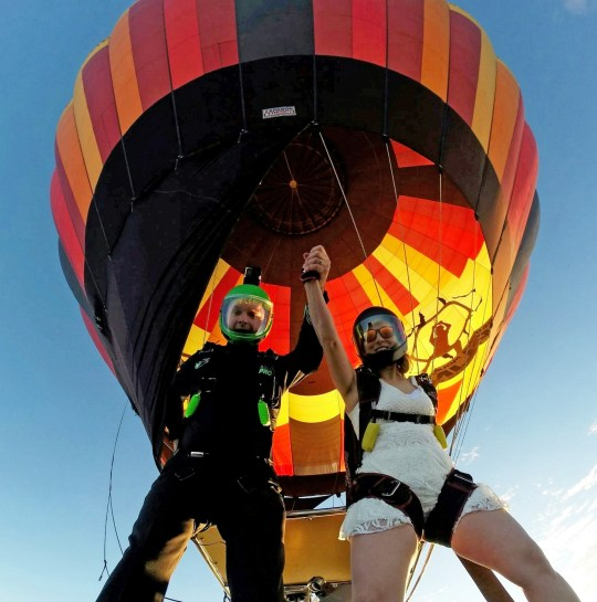 The couple jump out of the hot air balloon after getting married. This amazing footage shows the moment an adrenaline-junkie couple skydived from a hot air balloon after tying the knot - in front of guests packed into the basket. See story SWJUMP. Patrick Russell, 38, and Melanie Ilemsky, 36, decided to have an airborne wedding due to their shared love of skydiving. The couple met at a skydive drop zone in New York and knew each other for two years before they got married, on their one-year anniversary. They invited only a few close friends and family as only ten people could fit in the hot air balloon. Melanie had her dress, which cost $20 from Amazon, especially adapted to incorporate her skydiving rig. Her mother, Tetiana Cymbal, was ordained so she could carry out the intimate ceremony - which was also the first time she had been in a hot air balloon.
