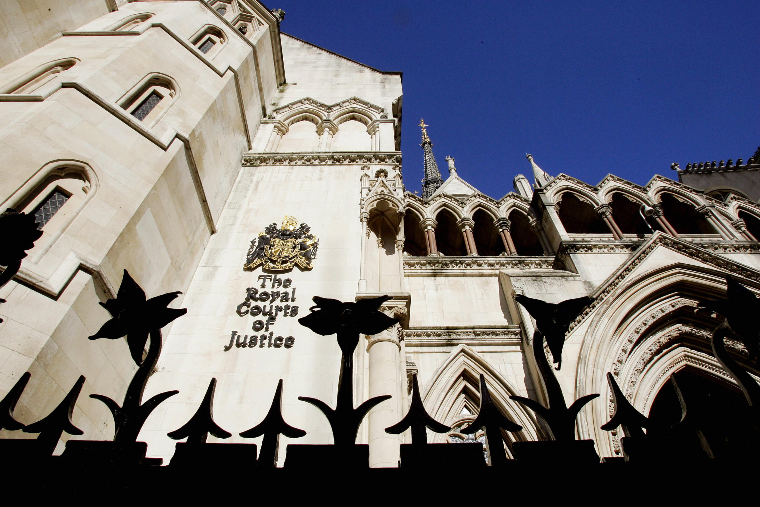 LONDON, UNITED KINGDOM: This picture shows the Royal Courts of Justice in London where Japan's Sumitomo Corporation has launched a suit against Credit Agricole 07 October, 2004. Sumitomo has begun a 1.1-billion-dollar damages claim against a unit of French bank Credit Agricole for allegedly turning a blind eye to massive unauthorised copper deals in one of the world's biggest rogue trading scandals. AFP PHOTO/ODD ANDERSEN (Photo credit should read ODD ANDERSEN/AFP/Getty Images)