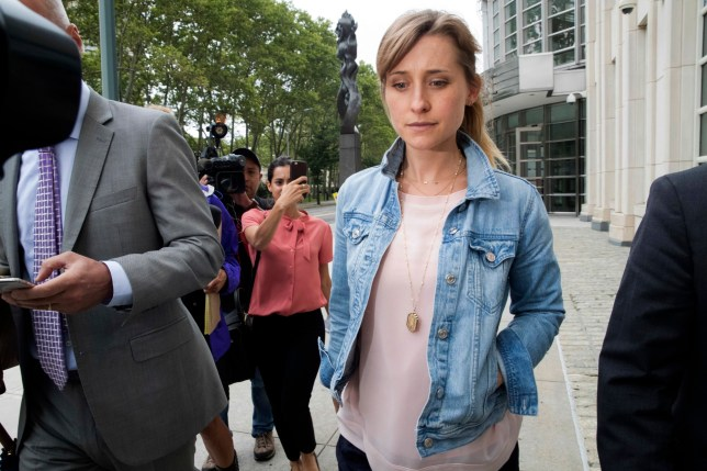 Actress Allison Mack, center, leaves Federal court, Wednesday, July 25, 2018, in the Brooklyn borough of New York. (AP Photo/Mary Altaffer)