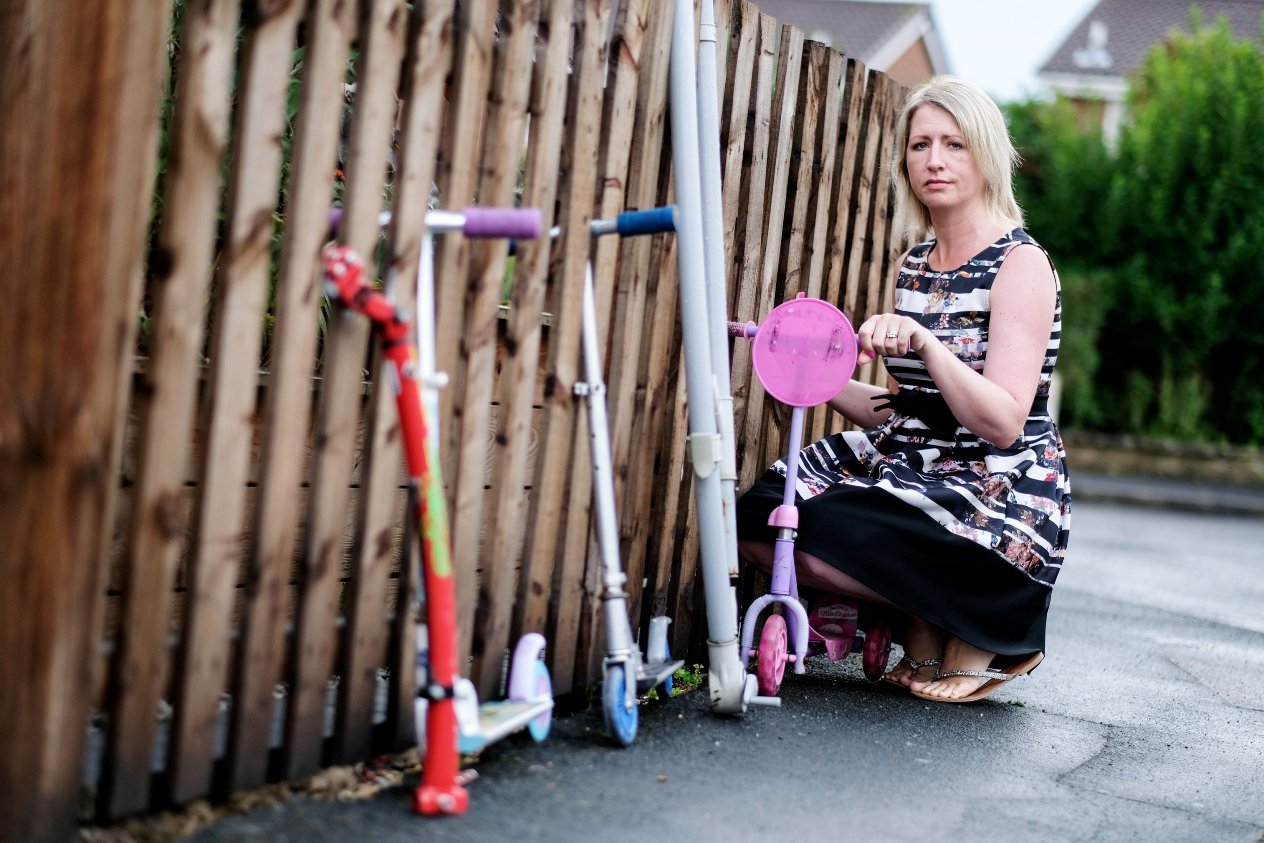 """Emma Reckless, 42, a teacher from Nottingham has been fined ?75 for leaving three scooters out for the scrap metal man, July 27 2018. Emma accepts she had not been in touch with the scrap man or left a note but she said one goes around nearly every day and has previously left stuff for them to collect. See NTI story NTIFINE. A primary school teacher was slapped with a ?75 fine for fly-tipping after leaving a few things outside her Bulwell house for the scrap metal man to collect. Emma Reckless, 42, put three children's scooters and a parasol holder on the street outside her house for picking up but instead got a knock on the door from a CPO on Tuesday, (July 24). The Nottingham resident accepts she had not been in touch with the scrap man or left a note but she said one goes around nearly every day and has previously left stuff for them to collect. She also said her neighbours do the same thing. She and her local councillor Ginny Klein both believe there should be some flexibility and residents need to be made more aware that putting out scrap metal is considered """"illegal"""" by Nottingham City Council. The mum-of-two described it as ?ridiculous? and said ?I was really shocked and really upset."""