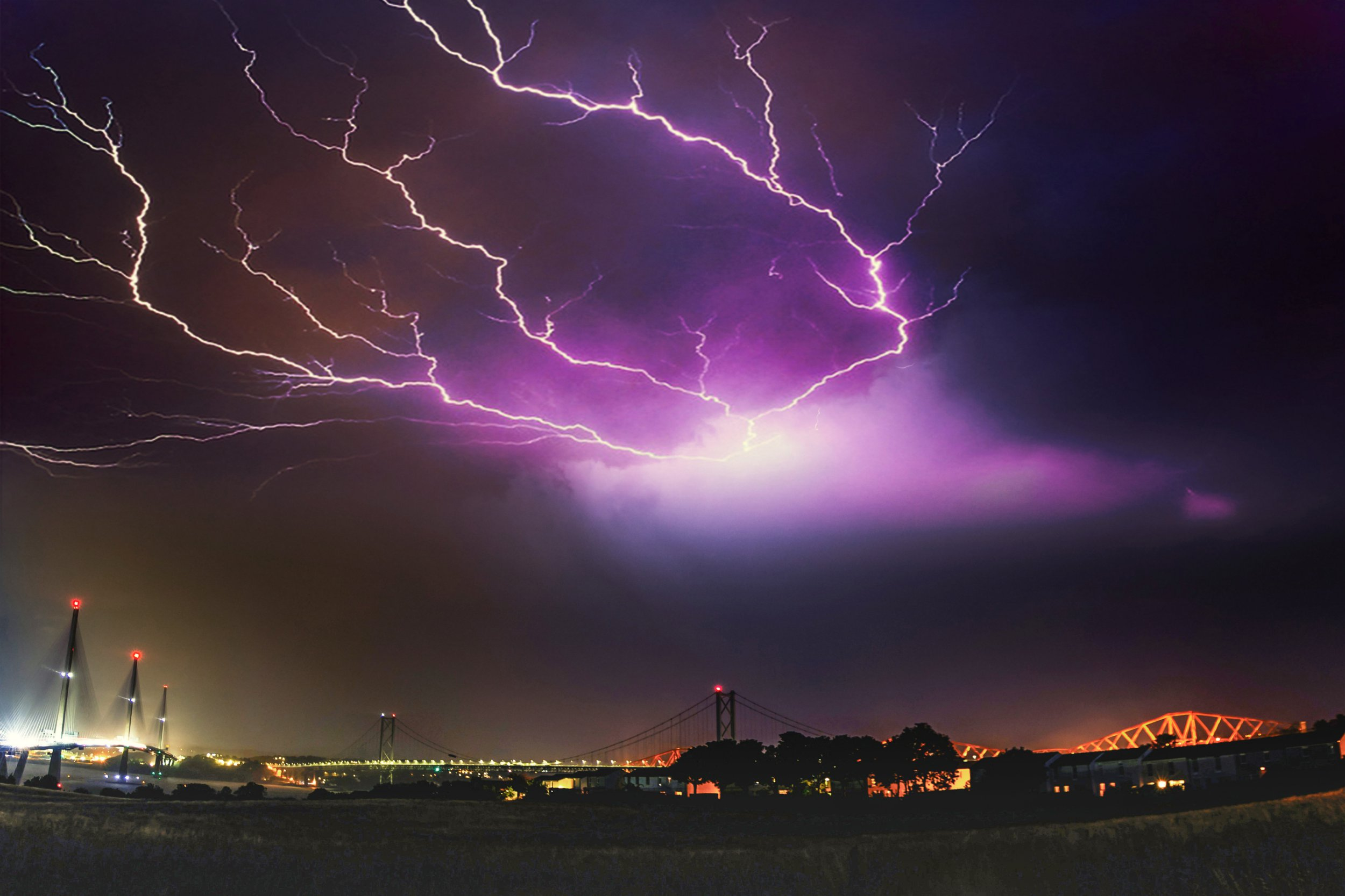 An amazing image of fork lightning above the three bridges over the Firth of Forth with the new Queensferry Crossing (left), The Forth Road Bridge (middle) and the Forth Rail Bridge (right). Sebastian Kuczynski from Edinburgh caught the strike while standing in South Queensferry at 1pm on July 26 2018