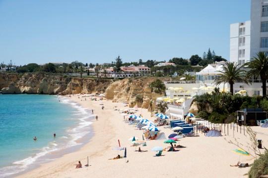 The beach in the Algarve town of Armacao de Pera southern Portugal. (Photo by: Education Images/UIG via Getty Images)