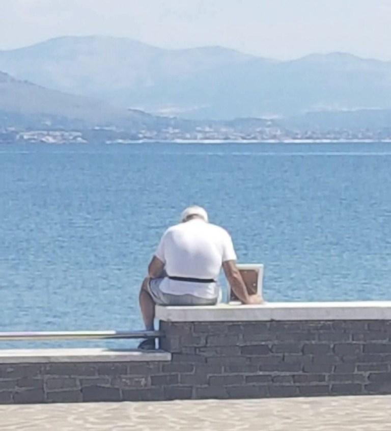 PIC FROM CATERS NEWS - (PICTURED Giuseppe with the framed photo ) This old man was captured going to the beach every day with a framed picture of his late wife- an image that quickly became viral on social media. Giuseppe Giordano, 70 a pensioner, has been going every day at the same time, to the same small beach in Gaeta, Italy, with the photo of his wife, just sitting there and looking at the sea. Giorgio Moffa, the owner of a nearby pizzeria first saw Giuseppe in early June and and posted his photo on his social media- it quickly became viral so Giorgio decided to approach him and have a chat, certain that there was a big love story behind it. SEE CATERS COPY