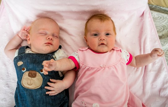 ***EMBARGOED UNTIL 14.00 BST, TUES JULY 31ST *** Twins Poppy and Piran House, at their home in Camborne, Cornwall. Meet the one-in-500 million twins - whose mum discovered she had two wombs when she found out she was pregnant with a baby in each. See SWNS story SWTWINS; Meet the one-in-500 million twins - whose mum discovered she had two wombs when she found out she was pregnant with a baby in each. Poppy and Piran House were born at 34 weeks after parents Jennifer Ashwood and Andrew House found out she had a rare 'heart shaped' uterus. Remarkably, she became pregnant with twins when one egg was released into each uterus - and they were both successfully fertilised at the same time. Doctors told the family the chances of having twins in this way was one in 500 million.