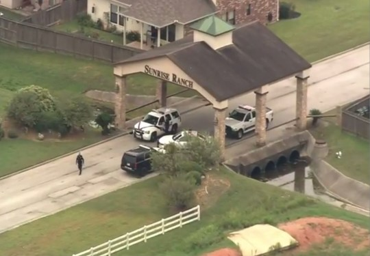 http://www.fox26houston.com/news/shooting-investigation-underway-in-sunrise-ranch-subdivision?utm_source=dlvr.it&utm_medium=twitter Officers are investigating what they're calling a suspicious shooting incident just houses away from where a mystery woman was ringing doorbells earlier this week. The Montgomery County Sheriff's Office has blocked off access to the Sunrise Ranch subdivision.The shooting happened in the 18400 block of Sunrise Pines. No further details on the shooting are available. TO GO WITH STORY: The boyfriend of the handcuffed woman who was seen frantically ringing doorbells at 3am in the morning, killed himself Wednesday with a single shot to the head, cops have confirmed to DailyMail.com. But the woman, 32, is safe and is now being consoled by her family, Montgomery County Sheriff's Department spokesman Lt. Scott Spencer said. The new development in Montgomery, Texas, adds a wrinkle to the mystery of why the woman dressed only in a T-shirt was desperately looking for help in the early hours. Cops said she is not Caitlin Dennison, the 19-year-old who went missing from Reno, Nevada, in January and whose sister believed tattoos on the two women matched. The dead man is still to be identified publicly. Spencer, a lieutenant with the Montgomery County Sheriff's Department said he was 49 and confirmed that the woman who had been ringing doorbells was his 32-year-old live-in girlfriend. 'She is originally from the Dallas area,' Spencer told reporters at an impromptu press conference a few hundred yards from the scene of the drama. 'The two were in a boyfriend/girlfriend situation.' He said investigators had not yet had a chance to interview her fully. Law enforcement cordoned off the entrance to the Sunrise Ranch development in Montgomery, a well-to-do city an hour north of Houston, allowing only residents in.Sheriff's deputies were called to the house in the 18400 block of Sunrise Pines Drive at 11 am on Wednesday, Spencer said. They were investigating 