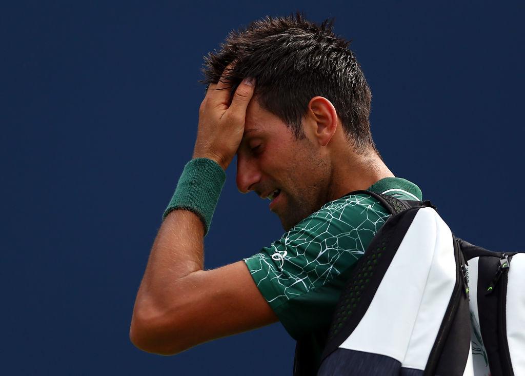 Wimbledon champion Novak Djokovic snaps racquet in half during shock Rogers Cup defeat