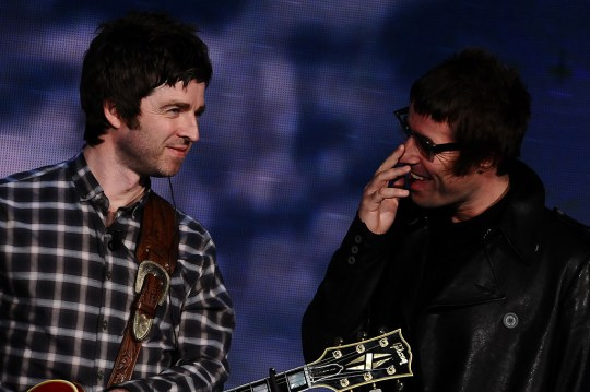 Oasis - Noel and Liam Gallagher performing