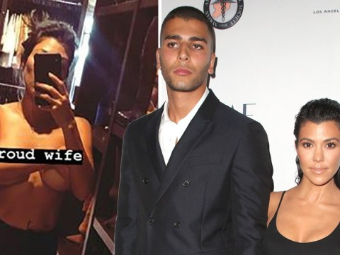 Kourtney Kardashian poses topless and calls herself a 'proud wife' after Younes 'attacks nightclub worker'