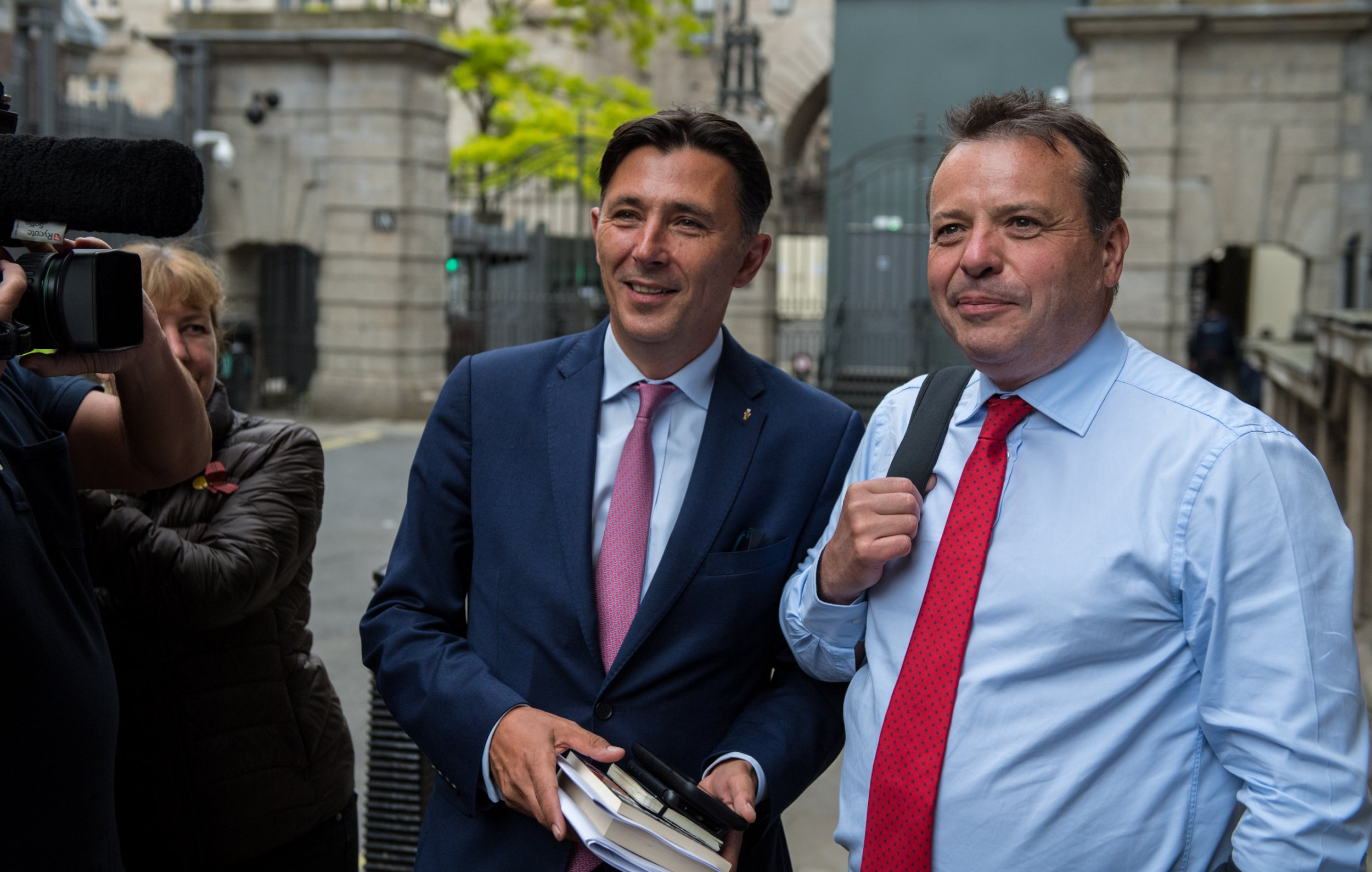 LONDON, ENGLAND - JUNE 12: Arron Banks (R) and Andy Wigmore (L) leave Portcullis House on June 12, 2018 in London, England. Leave EU backer Arron Banks appeared before the fake news select committee to answer questions. He arrived at Portcullis House with Andy Wigmore. (Photo by Chris J Ratcliffe/Getty Images)