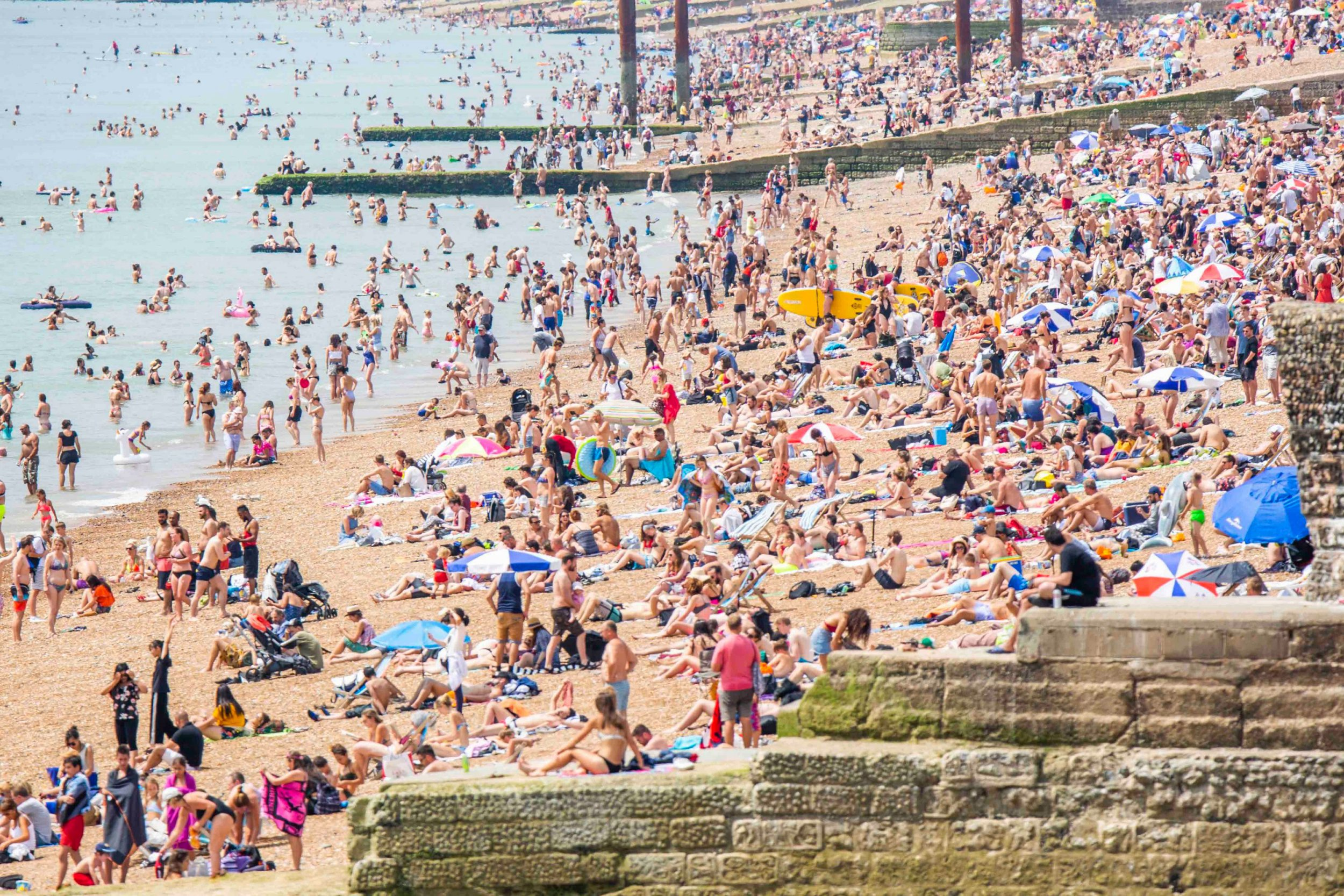 Mandatory Credit: Photo by Hugo Michiels/LNP/REX/Shutterstock (9745419e) Thousands of people take to the beach in Brighton and Hove as sunny and hot weather continues to hit the seaside resort. Seasonal weather, Brighton, UK - 08 Jul 2018