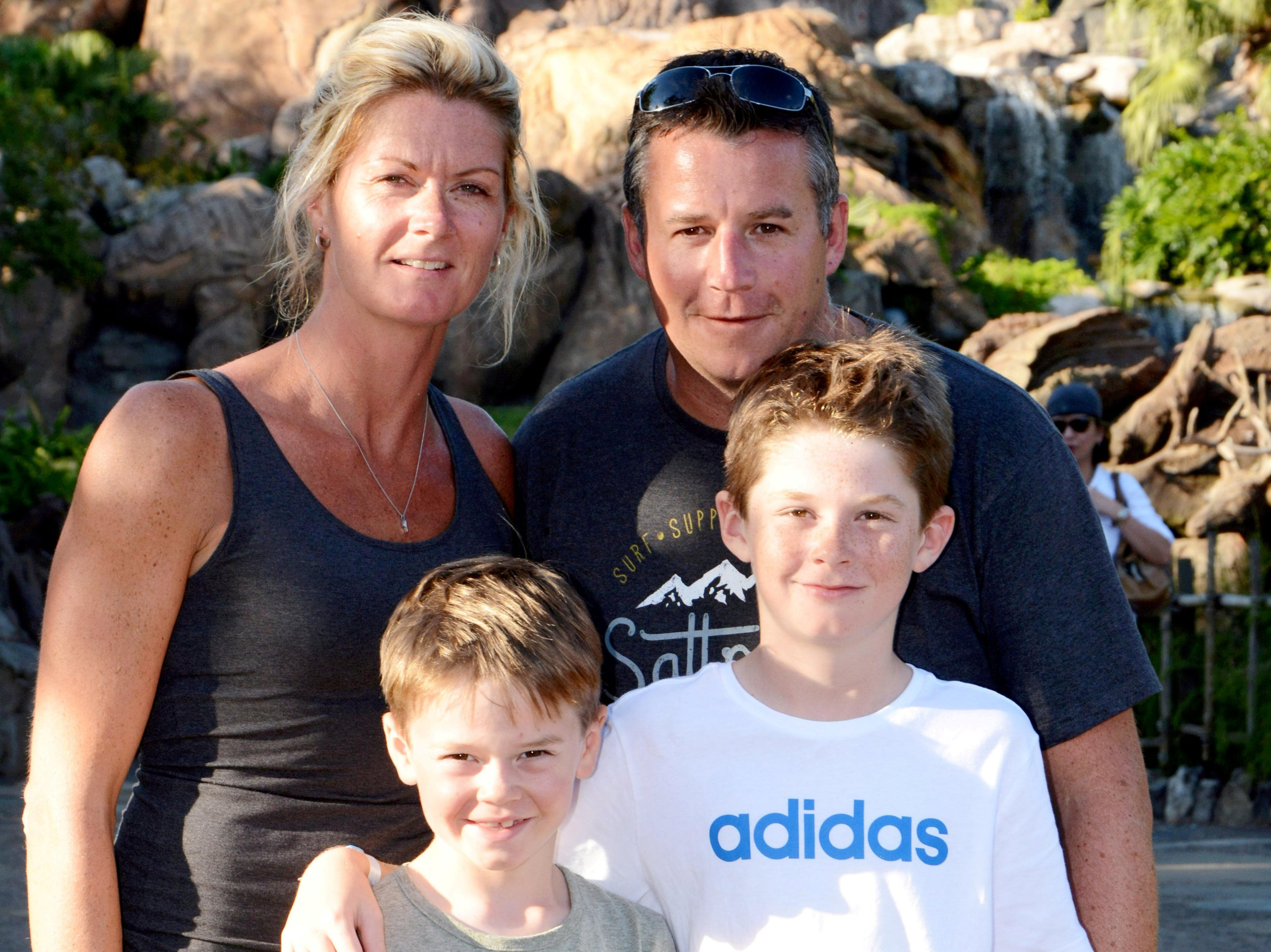 Simon and Kelly Stabb, with sons Jake & Luke. A policewoman has launched a ?200,000 fundraiser as part of a desperate bid to prolong her life for the sake of her children. See SWNS story SWFUND. Kelly Stabb, 39, was diagnosed with stage four bowel cancer in January 2017 and was led to believe her cancer was curable. But in February this year the mum-of-two was told the cancer had spread to other parts of her body. Until last week she had accepted her fate that she wouldn?t get to see her boys Jake, 10, and Luke, eight, grow into men or one day possibly enjoy becoming a grandparent with her husband Simon. Now a glimmer of hope exists thanks to a new drug trial, but as Kelly doesn?t meet its strict criteria she is having to find the ?200,000 it will cost to receive it as it is not available for her cancer on the NHS. Kelly, from Paignton, Devon, has already proved she is a good fundraiser having raised ?35,000 in just eight months for Bowel Cancer West (BCW) to try and help and support those who try to detect, cure and prevent the disease. Of the money raised, ?5,000 was also donated to the Ricky Grant Unit at Torbay Hospital. What she never expected was to find herself at the centre of a fundraising campaign in an attempt to prolong the precious time she has left with her boys.