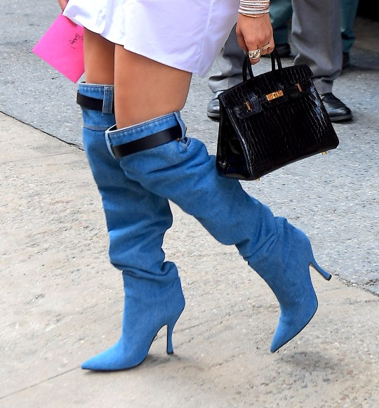 2c0ac0e2a044 American singer, Jennifer Lopez opted for no pants and Versace knee high  denim boots in