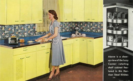 Vintage color photograph of a woman in a dress and heels standing in a kitchen with yellow steel cabinets and a steel countertop, preparing toast in a toaster for a breakfast platter, 1950s. Text of advertisement reads ???Above is a close-up view of the Lazy Corner rotating shelf cabinet featured in this Harrison Steel Kitchen???. (Photo by Found Image Holdings/Corbis via Getty Images)