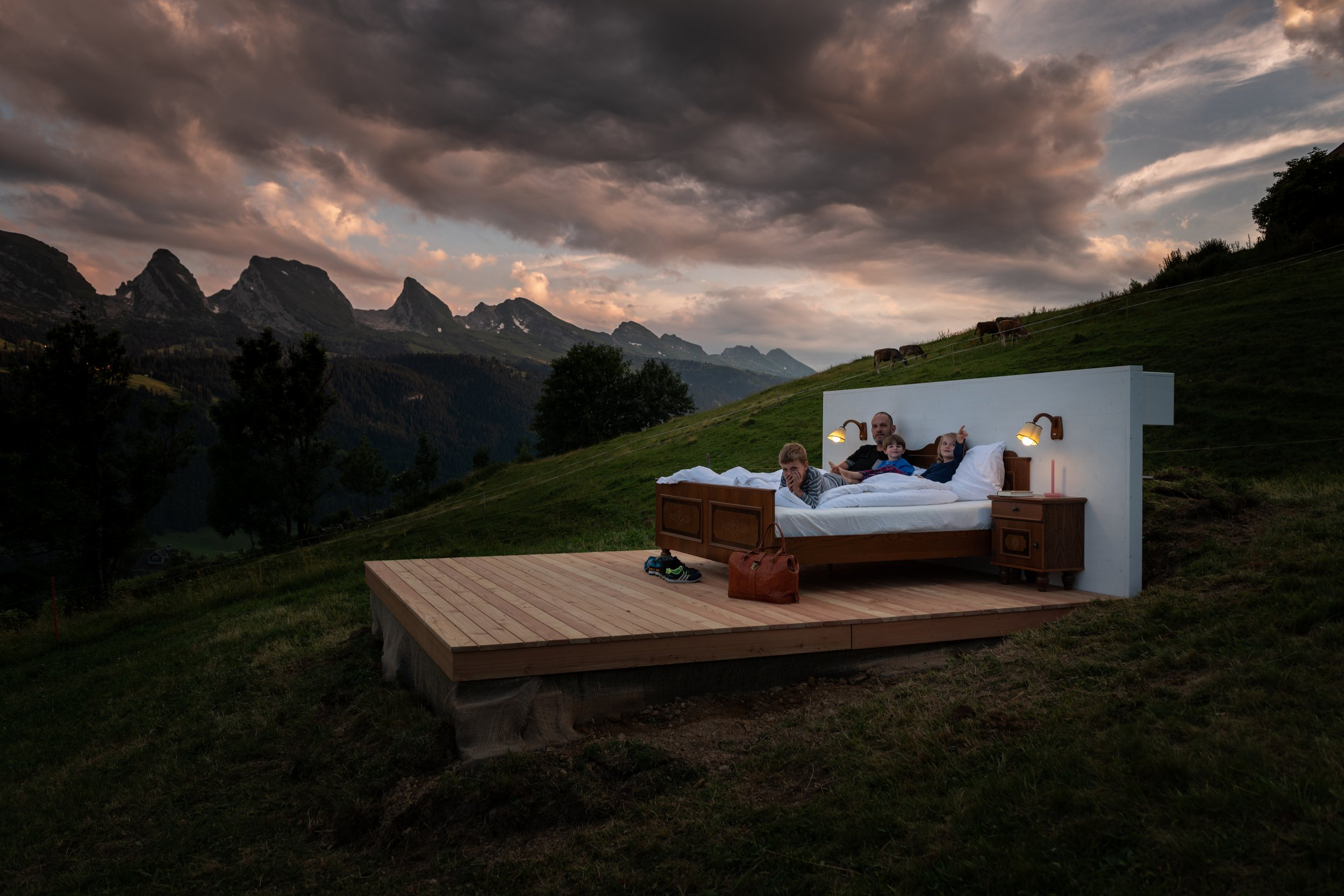 Could you sleep in a hotel that has no walls or roof? Zero Real Estate is a wall and window-free bed project set on a glorious mountainside spectacularly secluded in the Swiss Alps created by Swiss concept artists Frank and Patrik Riklin and their partner Daniel Charbonnier. Located in the alpine foreland of Wildhaus, Toggenburg the three ???hotel suites' allow you to lie under the sky surrounded with spectacular views of the Safien Valley. The experience begins with an easy check-in at the nearby Hotel Alpenrose. From there, your personal butler will escort you directly to your secluded Swiss paradise. The Burst Suite takes in the beauty of the S??ntis in all its glory, set high above the Toggenburg valley. Discover the Schwendi Suite above the sparkling Lake Schwendisee, with the distant chime of cowbells as your soundtrack. Finally, the Stump Suite lies under a canopy of ancient trees and birdsong, set conveniently close to the hotel sauna and spa. Completely unencumbered by windows and walls, you're free to admire your surroundings in all their captivating glory. Drift off amongst the emerging stars overhead... and with all that fresh mountain air, a sound night's sleep is all but guaranteed. When you wake, you'll find a tasty breakfast basket delivered directly to your bed - from which you may never, ever want to emerge again. The hotel suites under the stars are available through September 1st 2018 via https://toggenburg.org/de/zerorealestate.html but be aware that the hotel currently has a waiting list of 4,500 people! When: 01 Aug 2018 Credit: Zero Real Estate/Cover Images **All usages and enquiries, please contact info@cover-images.com - +44 (0)20 3397 3000EDITORIAL USE ONLY. MATERIALS ONLY TO BE USED IN CONJUNCTION WITH EDITORIAL STORY. COVER IMAGES DOES NOT CLAIM ANY OWNERSHIP OF THE MATERIALS. IMAGE/VIDEO COPYRIGHT REMAINS WITH THE PHOTOGRAPHER AND/OR SUPPLIER.**