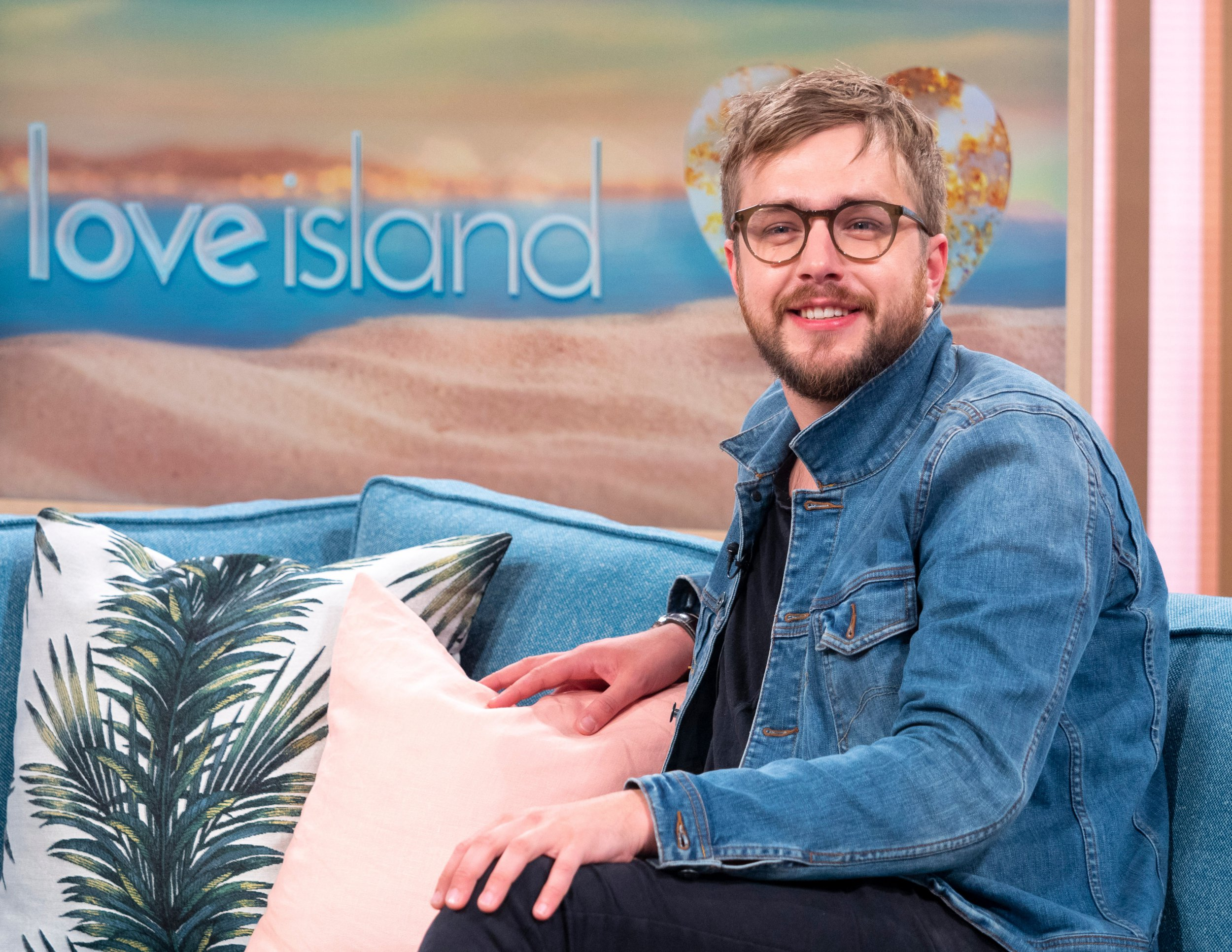 EDITORIAL USE ONLY. NO MERCHANDISING Mandatory Credit: Photo by Ken McKay/ITV/REX/Shutterstock (9697515as) Iain Stirling 'This Morning' TV show, London, UK - 31 May 2018 THE VOICE OF LOVE ISLAND IAIN STIRLING IS 100% OUR TYPE ON PAPER If grafting, mugging off and being pied means nothing to you, where were you last summer? Love Island was one of the hottest shows on our screens, and it?s back on Monday night. Who better to tell us all about the new series than the ?voice? of the show, narrator and comedian Iain Stirling. He?s here with everything you need to know, and what to expect this year. He?ll also be talking about his new book, ?Not Ready To Adult Yet?, his tour ?U OK Hun? X?, being loved up with presenter Laura Whitmore, and whether or not he?ll be invited to Caroline Flack?s wedding.