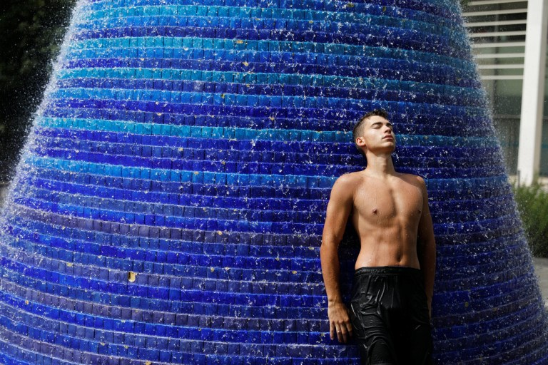 A man refreshes in a public fountain in Lisbon, Portugal August 4, 2018. REUTERS/Rafael Marchante