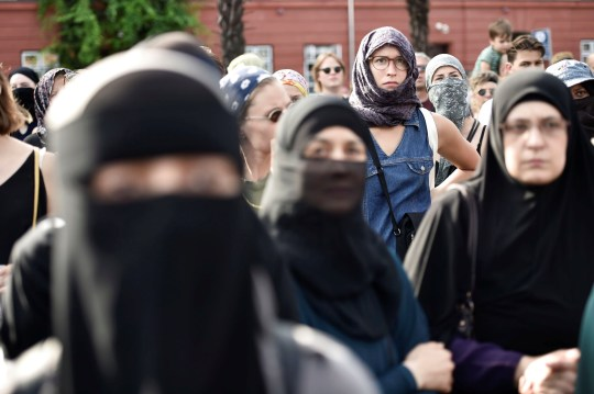 Demonstration on the first day of the implementation of the Danish face veil ban in Copenhagen, Denmark August 1, 2018. Mads Claus Rasmussen/Ritzau Scanpix/via REUTERS ATTENTION EDITORS - THIS IMAGE WAS PROVIDED BY A THIRD PARTY. DENMARK OUT. - RC1BE4C4D860