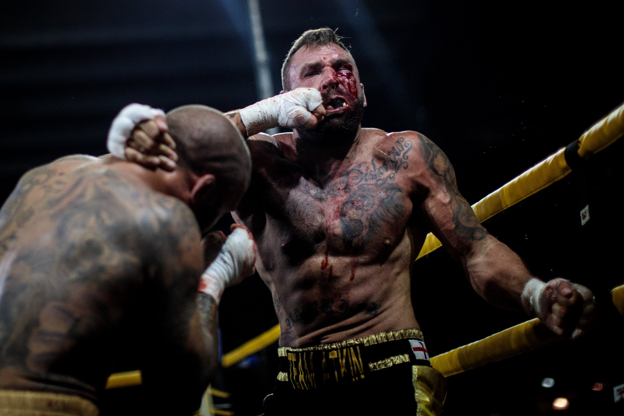 Gruesome pictures show brutal reality of bare knuckle boxing MANCHESTER, ENGLAND - AUGUST 04: Two-time World Bare-Knuckle Boxing Champion Luke Atkin, age 30 from York (R) is hit by Dom Clark, 35 from Bournemouth during the Rogue Elite world title main event at an Ultimate Bare Knuckle Boxing (UBKB) fight at Bowlers Exhibition Centre on August 4, 2018 in Manchester, England. The first formal bare-knuckle boxing bout in Britain was recorded in 1681 with the sport popularised by the end of the 17th century. The introduction of gloves into boxing with the Queensberry rules in 1867 eventually pushed bare-knuckle underground. Today the sport remains legal, but with no licensing body in place bare-knuckle in the UK is unregulated. Consisting of three 2-minute rounds or five 2-minute rounds for title fights, though rarely lasting that long, a fight sees boxers punch one another until knockout or until the referee or medic is forced to end it. Bare-knuckle boxing now looks set to shed its underground image and become more mainstream as the sports moves from pubs and car parks to bigger, more established venues. (Photo by Jack Taylor/Getty Images)