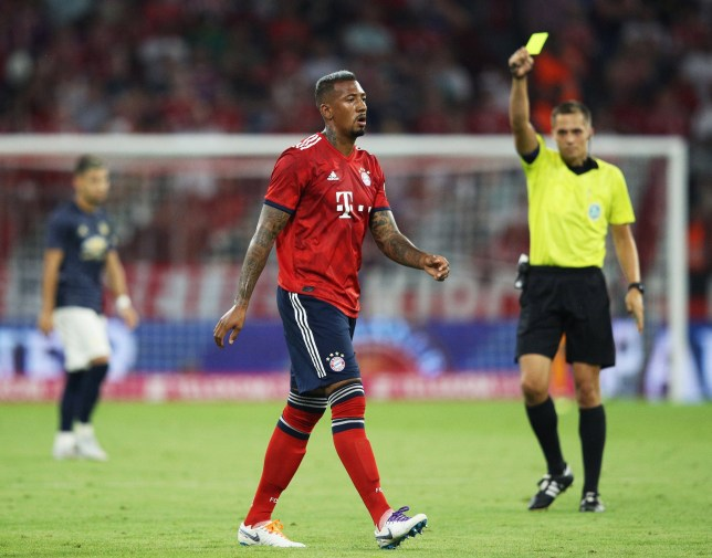 MUNICH, GERMANY - AUGUST 05: Jerome Boateng of Bayern Munich receives a yellow card during the Bayern Muenchen v Manchester United Friendly Match at Allianz Arena on August 5, 2018 in Munich, Germany. (Photo by Adam Pretty/Bongarts/Getty Images)