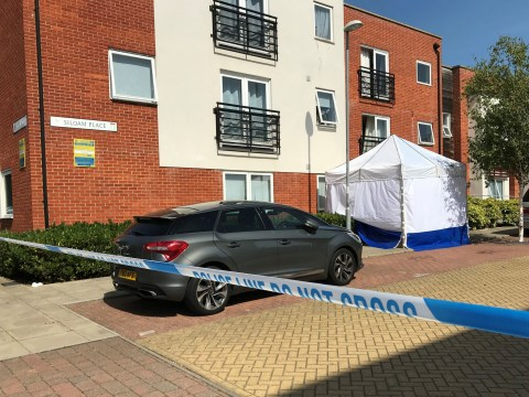 Investigation as man dies falling from flat with woman's body found inside