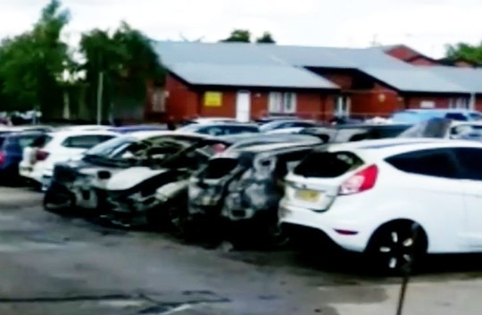 Armed police have surrounded a prison in Birmingham this afternoon [August 6] after ten cars were set alight in a suspected arson attack. Onlookers said two masked men reportedly carrying a firearm were seen to make off in a vehicle after the drama in a car park outside HMP Birmingham. Caption: Armed police outside HMP Birmingham, where up to ten cars were destroyed in a suspected arson attack on August 7, 2018