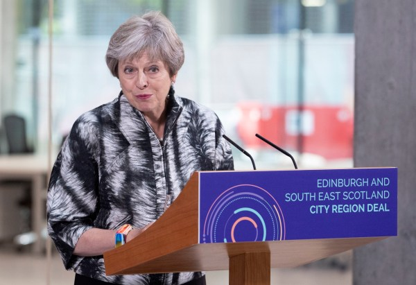 Prime Minister Theresa May speaks at the University of Edinburgh before signing the Edinburgh and South East Scotland City Region Deal. PRESS ASSOCIATION Photo. Picture date: Tuesday August 7, 2018. Theresa May will announce a ?1.2 billion city deal for Edinburgh and the south-east of Scotland, with both the Scottish and UK Governments committing ?300 million towards this. See PA story POLITICS Scotland. Photo credit should read: Jane Barlow/PA Wire