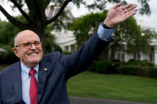 FILE - In this May 29, 2018, file photo, Rudy Giuliani, an attorney for President Donald Trump, waves to people during White House Sports and Fitness Day on the South Lawn of the White House in Washington. Giuliani, says special counsel Robert Mueller should finish the Russia investigation ???without further delay??? as the president???s legal team responded to the latest interview request. (AP Photo/Andrew Harnik, File)